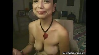 Asian granny masturbates on..