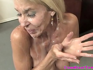 Busty granny cumblasted by..