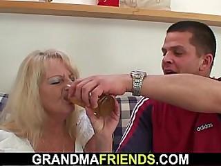Blonde granny takes two big..