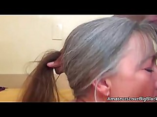 Grey haired granny enjoys..