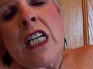 Blonde granny rubbing her..